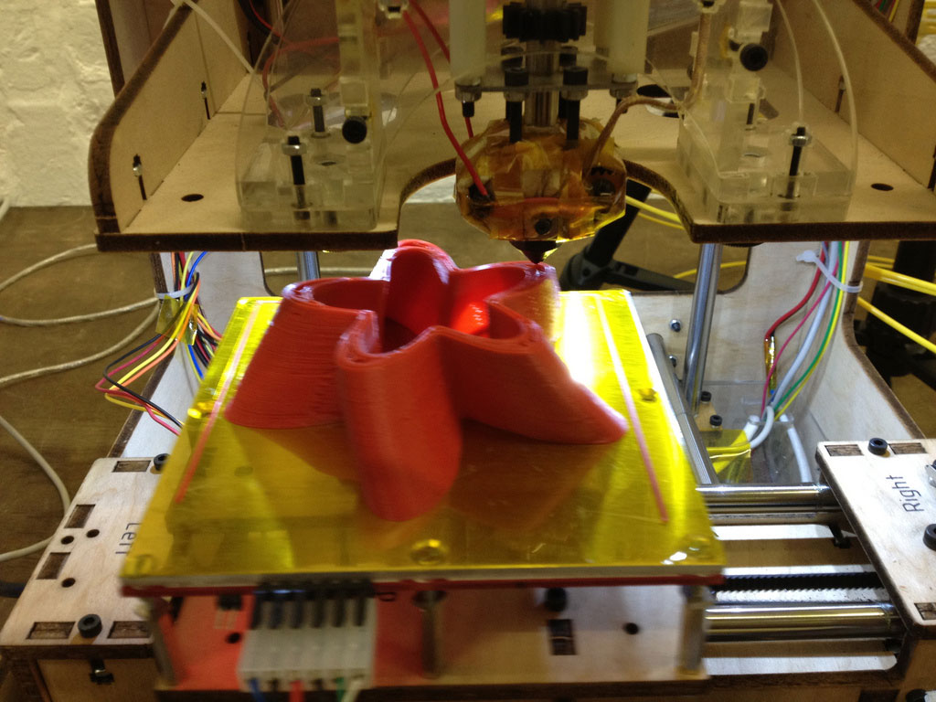 Red sculpture being printed on the Makerbot