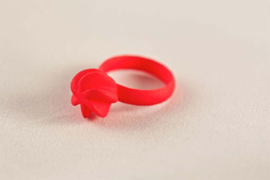 Red Flora ring on white background